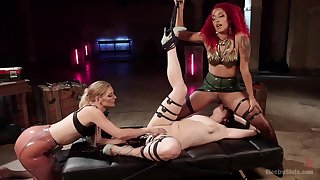 Mistress Daisy Ducati humiliates her two slaves increased by fists them