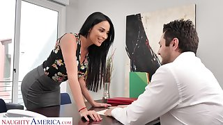 Femme fatale woman Anissa Kate offers herself sitting aloft the boss's table